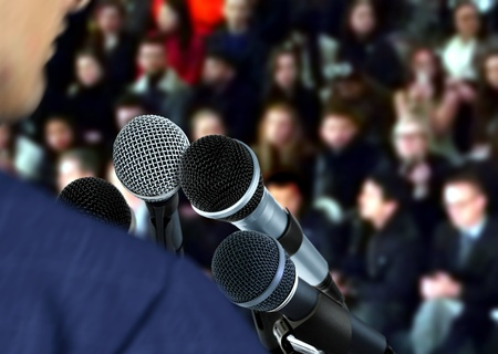 auditorium: Speaker at Seminar Giving Speech Stock Photo