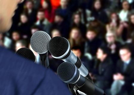 sound speaker: Speaker at Seminar Giving Speech Stock Photo