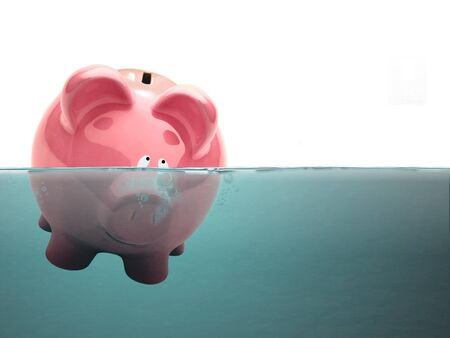 Drowning Piggy bank in water photo