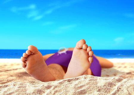 feet relaxing: Men Feet at the Beach