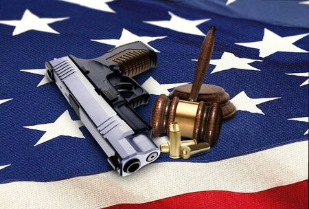 sidearm: Hand Gun with Gavel and Bullets on American Flag