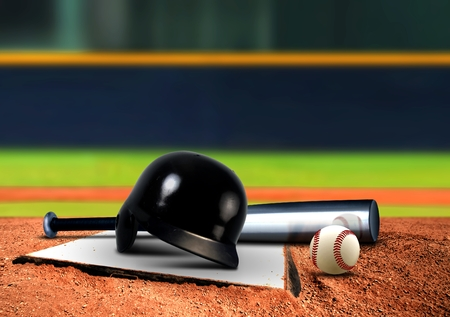 Baseball equipment on base Stock Photo