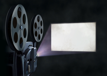 movie theatre: Movie projector and blank screen Stock Photo