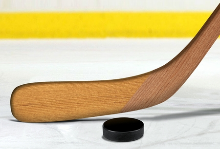 puck: Ice hockey stick and puck on rink