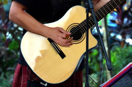 acoustical: Street performer playing guitar