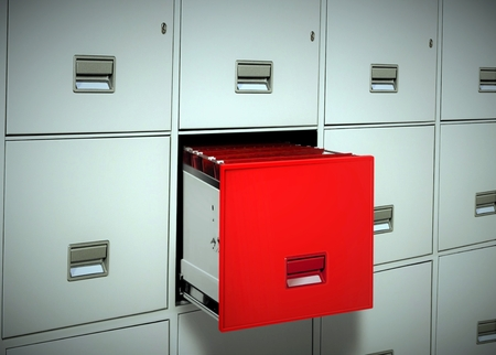 filing documents: Red file cabinet