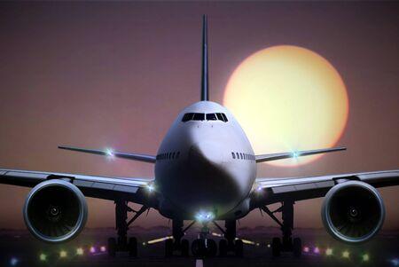landing light: airplane on runaway during sunset