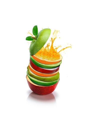 manzana verde: Rebanadas de la fruta de naranja con el chapoteo