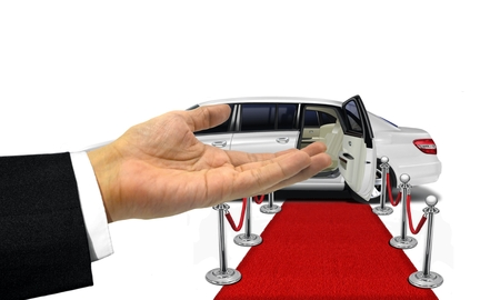 open car door: Welcome hand gesture to a white limousine Stock Photo