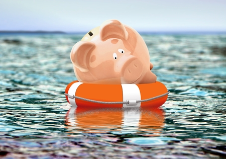 life support: Piggy bank on buoy floating on water