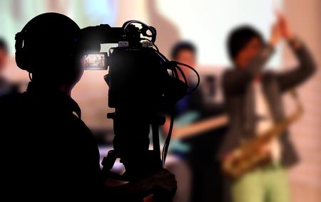 video cameras: Cameraman shooting a live concert Stock Photo