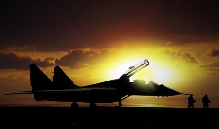 avion de chasse: Fighter jet sous le coucher du soleil sur les super-transporteur en mer
