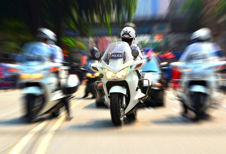 motorcycle officer: Policeman on motorcycle escorting government officials