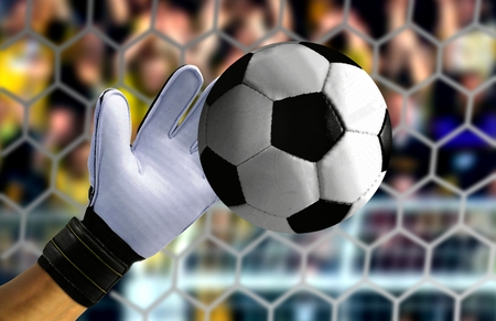 goal keeper: Goal keeper hand stopping a fast ball