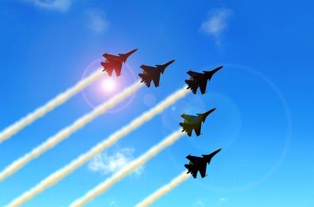 航空ショー: 軍曲技飛行ジェット航空ショー間に青い空の下で形成 写真素材
