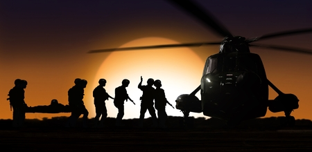 soldiers: Rescue helicopter with soldiers on ground during sunset