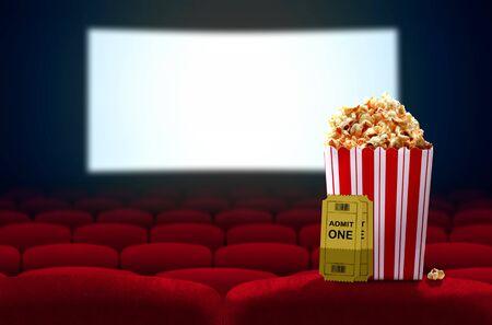 Cinema seat and pop corn facing empty movie screen