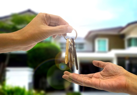 buyer: Purchasing  property with two hands and key