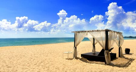 cabana: Beach cabana on sand facing open sea