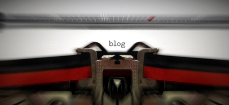 blogs: Blog written on old typewritter with zoom blur Stock Photo