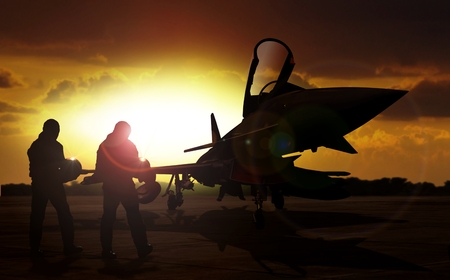 military aircraft: military aircraft on airfield with pilot walking towards the aircraft