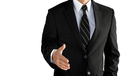 deal: Business man with an open hand ready to seal a deal over white Stock Photo