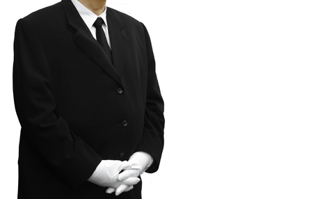 chauffeur: man in black suit standing over white