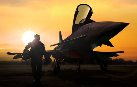 Military pilot and aircraft at airfield on mission standby Archivio Fotografico