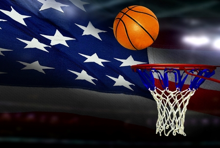 Basketball shot to the hoop with American flag background