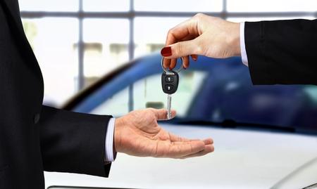 key handover: Car key handover at showroom