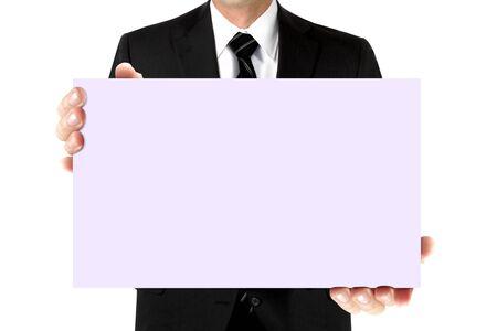 Man in suit holding blank card board 写真素材