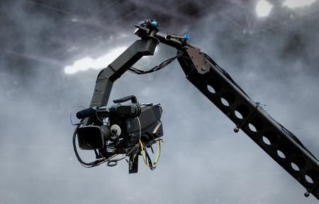 Camera on crane shooting in a stadium