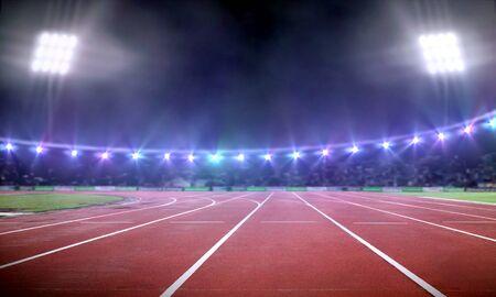 Empty stadium with running track under spotlight at night