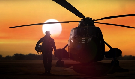 Helicopter silhouette on the ground during sunset 写真素材