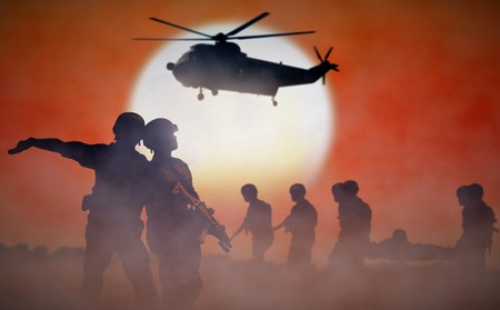 Military helicopter rescue mission during sunset 写真素材