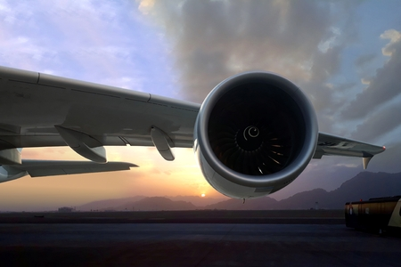 Commercial airplane turbine engine on runway