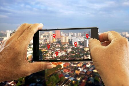 Hand holding smartphone seaching for location