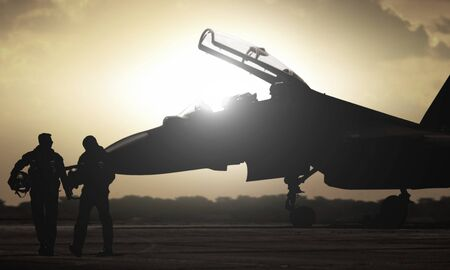 Military aircraft pilot walking during sunset