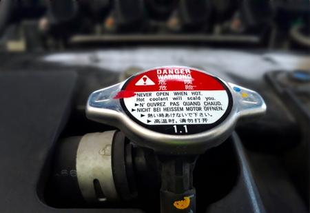 Car radiator cap with warning sign