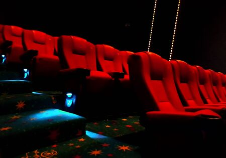 entertainment event: Empty red cinema or theater seats