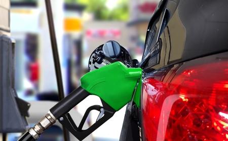 Car fueling petrol at station 写真素材