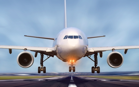 Airplane taking off from airport runway