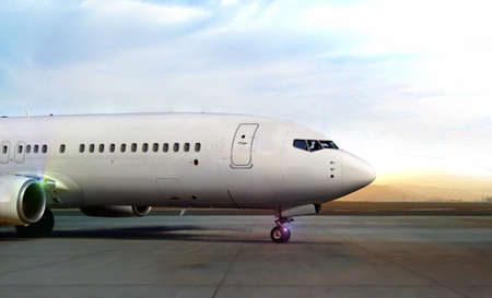 Airplane on runway during sunset 写真素材