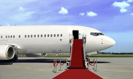 Boarding commercial  airplane with red carpet presentation