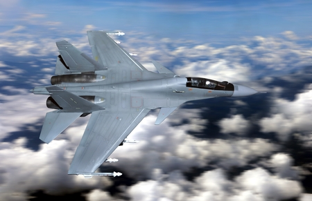 Military fighter jet flying above cloudy sky 写真素材