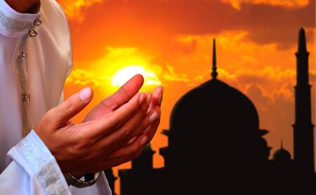 Praying hands with sunset background