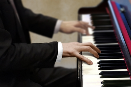 Man in black suit playing piano 写真素材