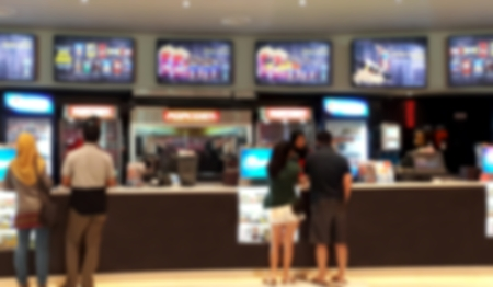 People buying snack at cinema food counter