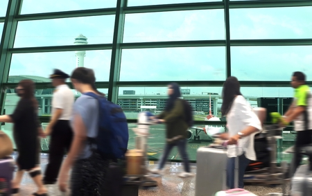 People arrival at the airport terminal