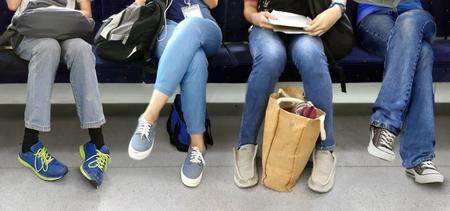 People sitting inside subway train